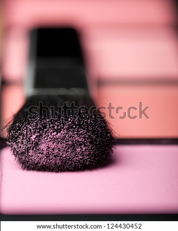 makeup brush and cosmetic powder close up - stock photo