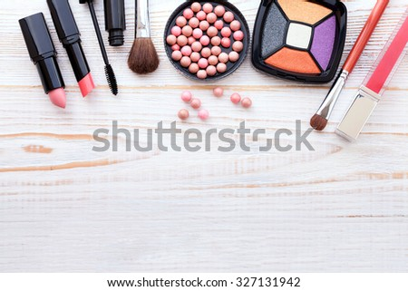 makeup brush and cosmetics make up artist objects: lipstick, eye shadows, eyeliner, concealer, nail polish, powder, tools for make-up - stock photo