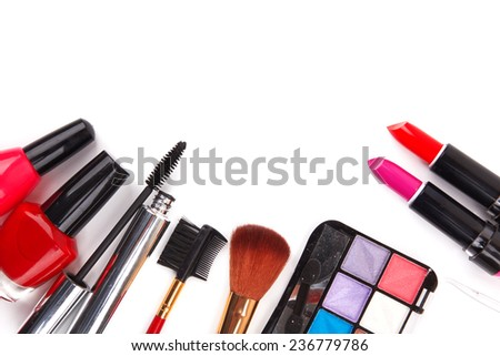 makeup brush and cosmetics on white background - stock photo