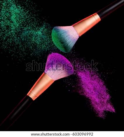Makeup Brush Powder Explosion On Black Background