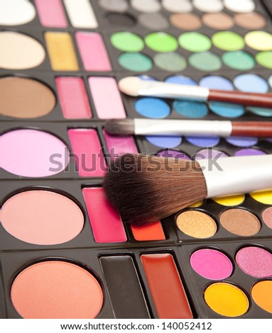 Makeup brushes and makeup eye shadows - stock photo