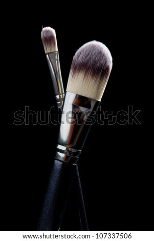 Makeup Brushes on a black background - stock photo