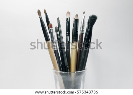 Makeup brushes set for women with white background.