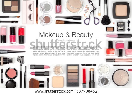 makeup cosmetics and brushes on white background  - stock photo