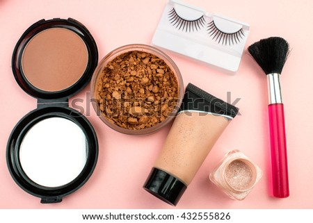 Makeup Cosmetics on Pink Background.