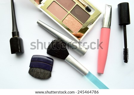 Makeup Eyeliner brush with bottle ,set of cosmetics,Make-up and brushes,powder, puff, mascara, eyeliner on on a white background - stock photo