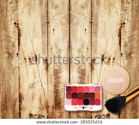 Makeup Eyeliner brush with bottle ,set of cosmetics,Make-up and brushes,powder, puff, mascara, eyeliner on wood table - stock photo