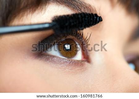 Makeup. Make-up. Applying Mascara. Long Eyelashes - stock photo