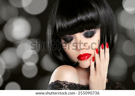 Makeup. Manicured nails. Beauty girl portrait. Back short bob hair. Hairstyle. Smokey eyes.   - stock photo