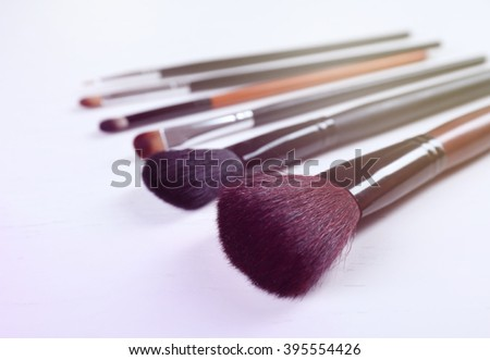 Makeup tools on a light background