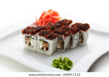 Maki Sushi - Roll made of Cream Cheese, Tamago, Cucumber and Smoked Eel inside. Topped with Red and Black Tobiko - stock photo