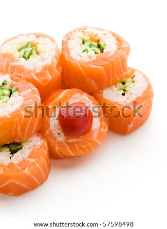 Maki Sushi - Roll made of Cucumber and Sesame inside. Fresh Salmon outside