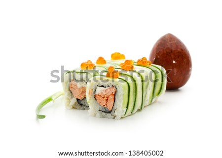 Maki Sushi - Rolls with Fried Salmon and Cream Cheese insisde. Cucumber outside. Topped with Ikura (salmon roe) - stock photo