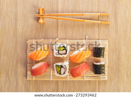 Maki Sushi set on wooden background - stock photo