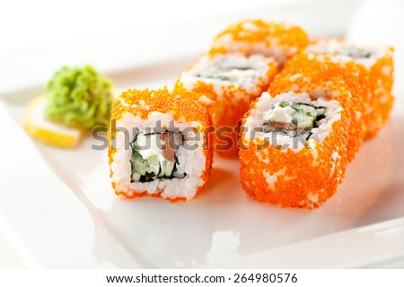 Maki Sushi with Fresh Salmon, Cucumber and Cream Cheese inside. Tobiko outside - stock photo