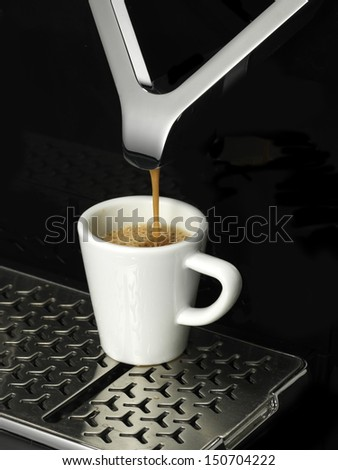 Making a cup of espresso - stock photo