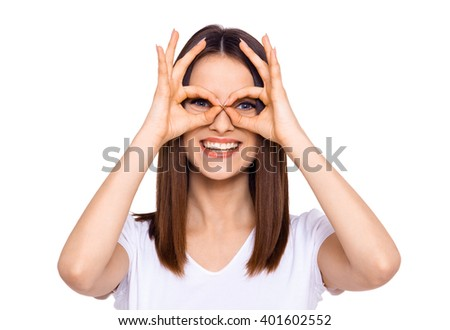 Making a face. Cheerful young woman making a face and gesturing while standing isolated on white - stock photo