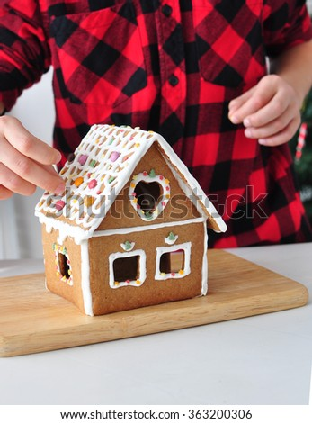Making a Gingerbread House - stock photo