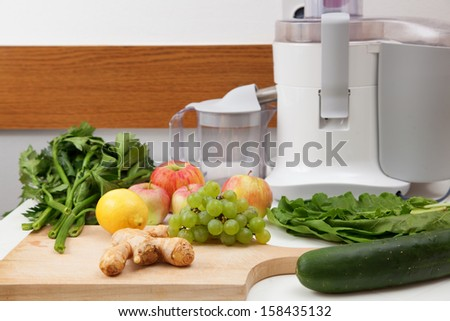 Making a healthy green juice - stock photo