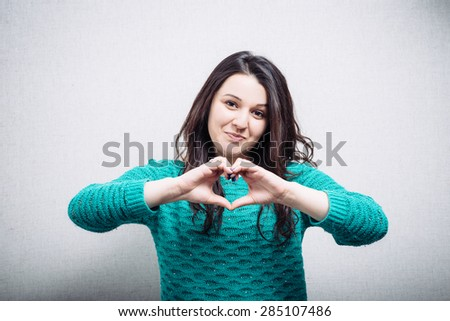 Making a heart hand gesture - stock photo