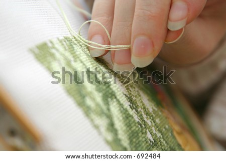 Making a Holiday Cross Stitch - stock photo