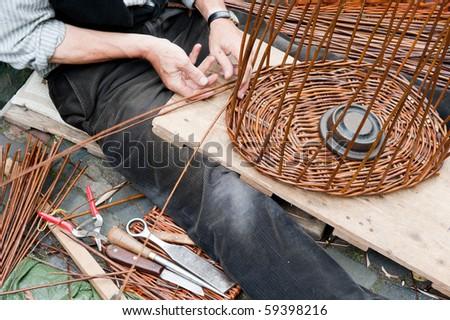 Making a wicker basket - stock photo
