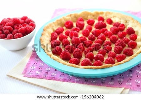Making Almond tart with raspberries and white chocolate - stock photo