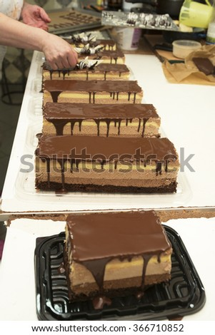 Making and decorating chocolate cake, homemade work - stock photo