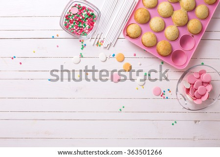 Making cake pops on white wooden background. Selective focus.Place for text. - stock photo