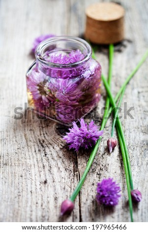 Making chives blossom vinegar from fresh ingredients - stock photo