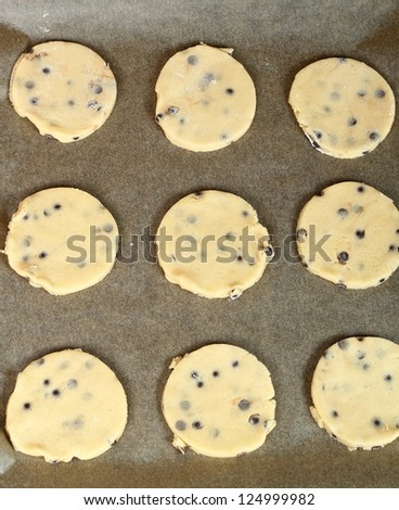 Making Chocolate Chip Cookies. Series. Raw cookies ready for baking. - stock photo