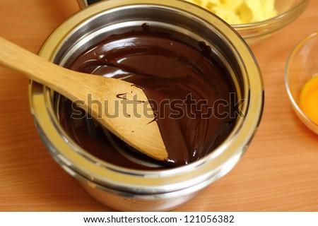 Making Chocolate Sponge Cake. Series. Melting Chocolate. - stock photo