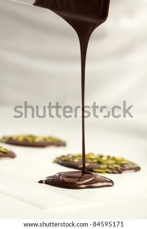 Making chocolate tuiles - stock photo