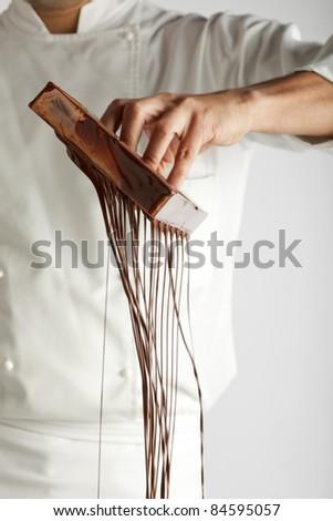 Making chocolates - stock photo