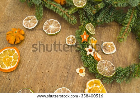 Making Christmas advent wreath. Christmas wreath on a rustic wooden board. Top view - stock photo