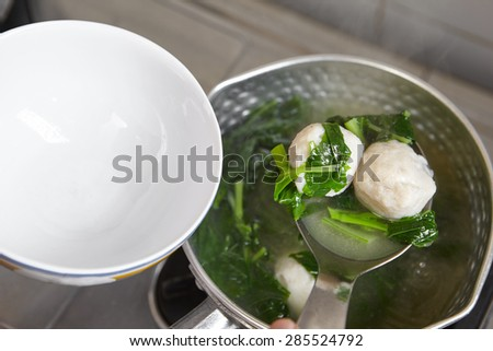 Making fish ball soup with green vegetable - stock photo