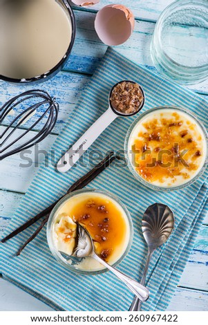 making homemade creme brulee with ingredients - stock photo
