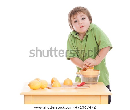 Making Lemonade. Adorable preschooler making lemonade.  Isolated on white.