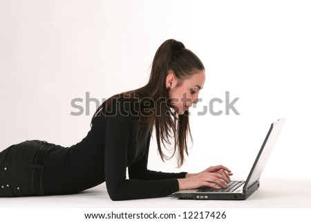 making look younger girl with laptop in house - stock photo
