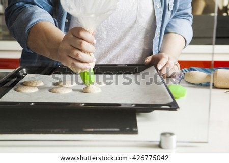 Making Macarons In The Kitchen - stock photo