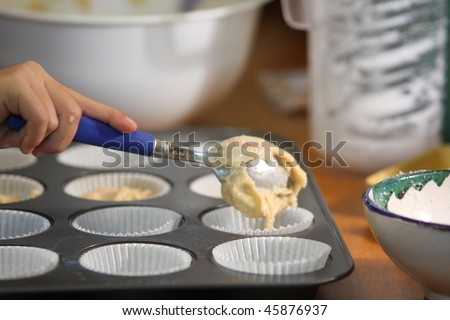 Making muffins in the kitchen - stock photo