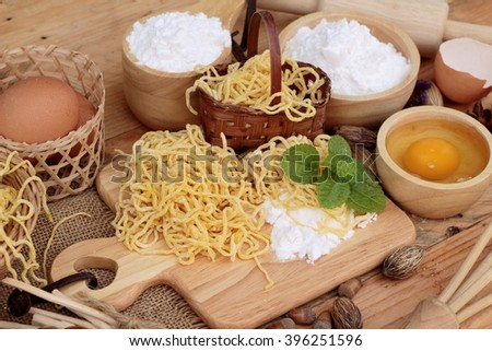 Making noodle with wheat flour and egg for cooking - stock photo