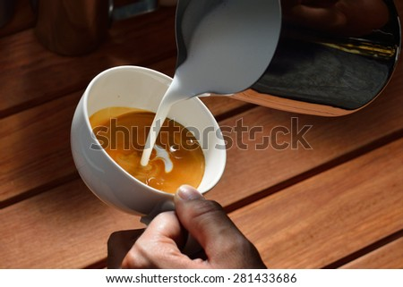 Making of cafe latte art, bird shape - stock photo