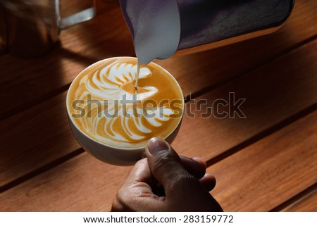 Making of cafe latte art,Swan shape - stock photo
