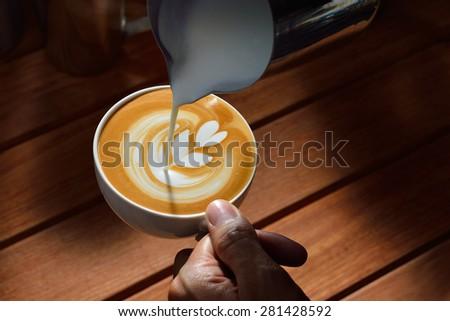 Making of cafe latte art,Tulip - stock photo