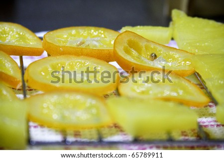 Making off Delicious sweets: caramelled oranges with chocolat - stock photo