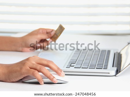 Making online purchase on a laptop using a credit card