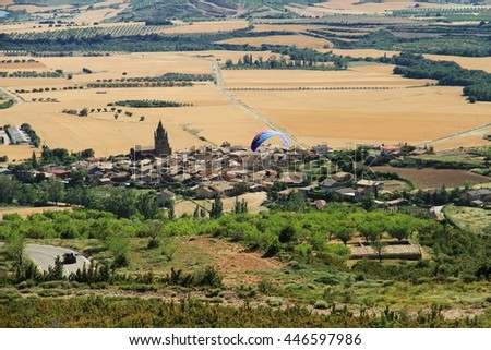Making paragliding over Loarre town in Spain