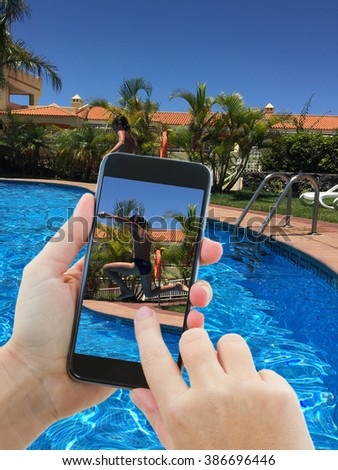 making photo of boy jumping in swimming pool - stock photo