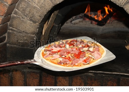 making pizza - stock photo